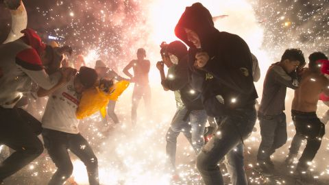 Crowds jump around as rockets rain down at the National Pyrotechnic Festival in Tultepec in March.