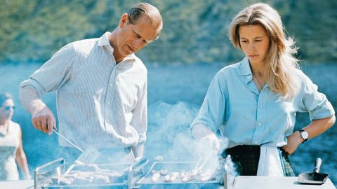 Prince Philip and his daughter, Princess Anne, prepare a barbecue on the Balmoral Castle estate in August 1972.