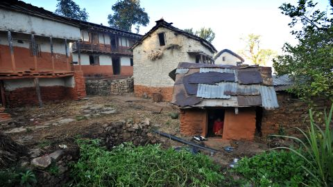 """TO GO WITH Nepal-women-religion-society-chhaupadi,FEATURE by Frankie Taggart Thirteen year old Nepalese villager Sarswati Biswokarma sits inside a """"chhaupadi house"""" in the village of Achham, some 800kms west of Kathmandu on November 23, 2011.  Isolation is part of a centuries-old Hindu ritual known as chhaupadi which is blamed for prolongued depression, young women's deaths and high infant mortality rates in remote, impoverished western Nepal. Under the practice women are prohibited from participating in normal family activities during menstruation and after childbirth.     AFP PHOTO/Prakash MATHEMA (Photo credit should read PRAKASH MATHEMA/AFP/Getty Images)"""