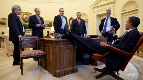 Obama speaks with aides in the White House Oval Office in February 2009. From left are Senior Advisor Pete Rouse, White House Director of Legislative Affairs Phil Schiliro, Axelrod, National Economic Council Director Lawrence Summers and Emanuel.