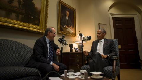 """Obama and Axelrod sit together in the White House as they tape a podcast for the <a href=""""http://rss.cnn.com/services/podcasting/axe/rss"""" target=""""_blank"""">""""Axe Files""""</a> in December 2016."""