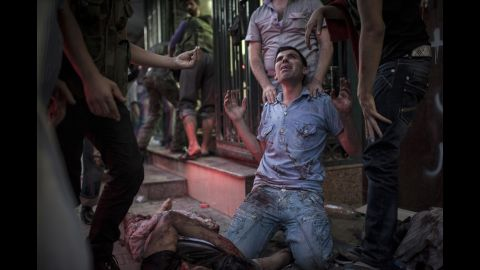 A man in front of a field hospital mourns the death of his relatives on August 21, 2012, in Aleppo.