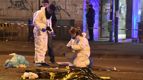 """Italian police and forensics experts gather around the body of suspected Berlin truck attacker Anis Amri after he was shot dead in Milan on December 23, 2016.   The Tunisian man suspected of carrying out the deadly Berlin truck attack at the Christmas market was shot dead by police in Milan on December 23, Italy's interior minister Marco Minniti said. The minister told a press conference in Rome that Anis Amri had been fatally shot after firing at two police officers who had stopped his car for a routine identity check around 3:00 am (0200 GMT). Identity checks had established """"without a shadow of doubt"""" that the dead man was Amri, the minister said. / AFP / DANIELE BENNATI        (Photo credit should read DANIELE BENNATI/AFP/Getty Images)"""