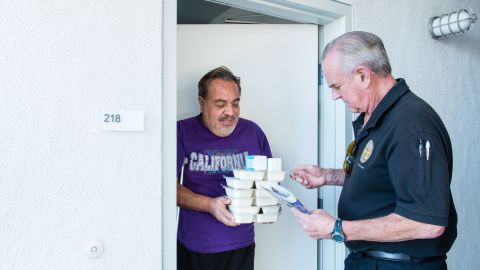 Meals on Wheels volunteer Mike Kearin delivers food to Los Angeles client Jesus Barron last year.