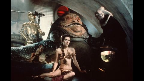 """Fisher stars in the film, """"Star Wars: Episode VI -- Return of the Jedi"""" in 1983. The 'gold bikini' is one of her most famous costumes as Princess Leia. In addition to her acting career, Fisher -- who was <a href=""""http://www.healthyplace.com/bipolar-disorder/articles/carrie-fisher-and-manic-depression/postcards-a-book-by-carrie-fisher/?t=s&url=/public_bookmarks.php"""" target=""""_blank"""" target=""""_blank"""">diagnosed with bipolar disorder at age 24</a> -- has lobbied as an advocate for mental health awareness and treatment and has spoken before the California state Senate."""