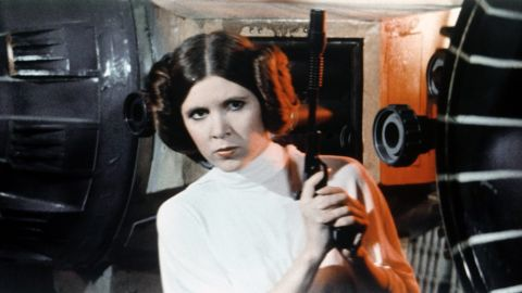 """Carrie Fisher is seen as Princess Leia on the set of George Lucas' """"Star Wars: Episode IV -- A New Hope"""" in 1977. The American actress and writer is best-known for her portrayal of Princess Leia in the """"Star Wars"""" movie franchise. Fisher was hospitalized December 23 in Los Angeles after suffering a heart attack. Fisher died on Tuesday, December 27. She was 60."""
