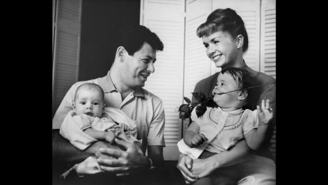 Fisher is photographed with her parents and brother, Todd, who was born in 1958.