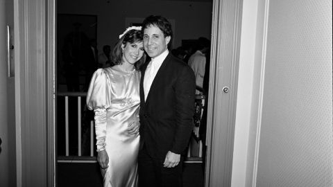 Musician Paul Simon poses for a picture with Fisher in 1983. The two were married in August and divorced about one year later in July 1984.