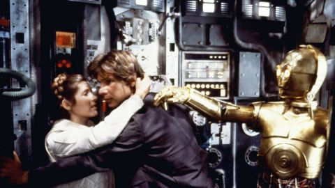 """Harrison Ford and Fisher embrace during filming of """"Star Wars: Episode V - The Empire Strikes Back"""" in 1980. On November 16, 2016, Fisher <a href=""""http://www.cnn.com/2016/11/16/entertainment/carrie-fisher-harrison-ford/index.html"""" target=""""_blank"""">revealed to People magazine that she and co-star Ford had an affair</a> during the 1976 filming of """"Star Wars."""""""