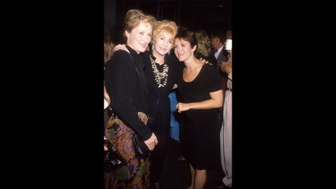 """Meryl Streep, left -- who portrayed a character based on Fisher in the film adaptation of Fisher's 1987 novel, """"Postcards from the Edge"""" -- is seen at the film's premiere in Century City, California, on September 10, 1990."""