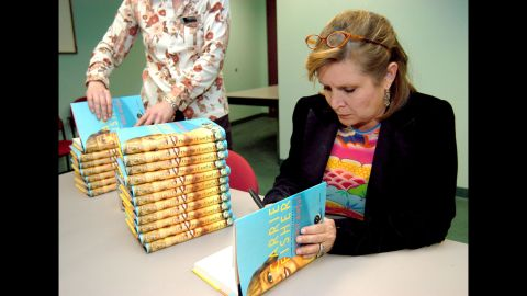 """Fisher attends a book signing for her novel, """"The Best Awful,"""" in Beverly Hills, California, in 2004. The semi-autobiographical novel fictionalized events from Fisher's life."""