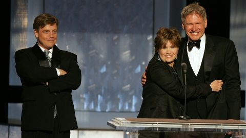 """""""Star Wars"""" trio Mark Hamill, left, Fisher and Harrison Ford speak during a tribute to filmmaker George Lucas at the 33rd American Film Institute Life Achievement Award event in Hollywood on June 9, 2005."""