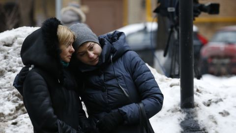Two women stand outside Alexandrov Hall, a rehearsal room of the Alexandrov Ensemble, in Moscow on Sunday. The ensemble, established in 1928, has toured the world performing Russian folk songs, World War II anthems and patriotic music.
