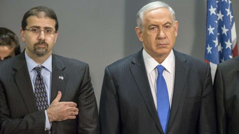 """Israeli Prime Minister Benjamin Netanyahu (R) and Daniel B. Shapiro (L) the US Ambassador to Israel listen to the US national anthem during the 14th annual International Conference on Counter-Terrorism in the coastal city of Herzliya, north of Tel Aviv, on September 11, 2014. Netanyahu  showed his support for US President Barak Obamas call for united actions against ISIS, calling for  """"all civilized countries"""" to stand together in the fight against radical terrorism. AFP PHOTO / JACK GUEZ          (Photo credit should read JACK GUEZ/AFP/Getty Images)"""