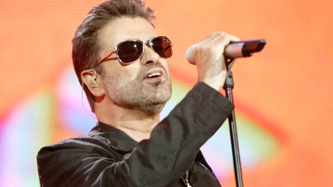 """LONDON - JULY 02:  Singer George Michael performs on stage at """"Live 8 London"""" in Hyde Park on July 2, 2005 in London, England.  The free concert is one of ten simultaneous international gigs including Philadelphia, Berlin, Rome, Paris, Barrie, Tokyo, Cornwall, Moscow and Johannesburg. The concerts precede the G8 summit (July 6-8) to raising awareness for MAKEpovertyHISTORY.  (Photo by MJ Kim/Getty Images)"""