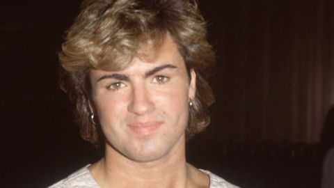 1984:  English pop star and one half of the duo 'Wham', George Michael, arriving at Heathrow Airport.  (Photo by Hulton Archive/Getty Images)