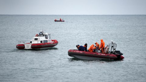 Emergency crews continue search operations on December 26.