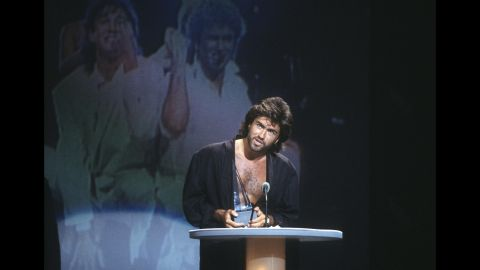 Michael accepts Wham!'s award for favorite pop/rock band group at the American Music Awards in January 1986.