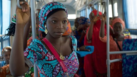 The girls ride the bus in Abuja en route to Chibok to reunite with their families.