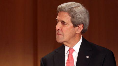 Secretary of State John Kerry listens while receiving the Federal Cross of Merit (Bundesverdienstkreuz) award on December 5, 2016 in Berlin, Germany.
