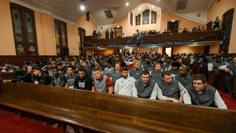 The players sit in the pews of the historic Ebenezer Baptist Church.