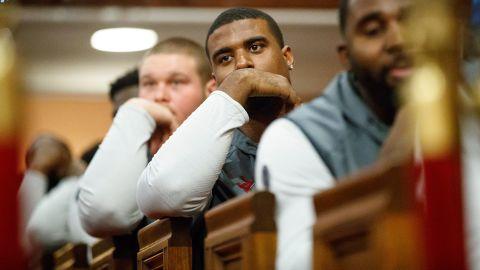 College football players from Alabama Crimson Tide and the Washington Huskies visit Historic Ebenezer Baptist Church on Tuesday night.