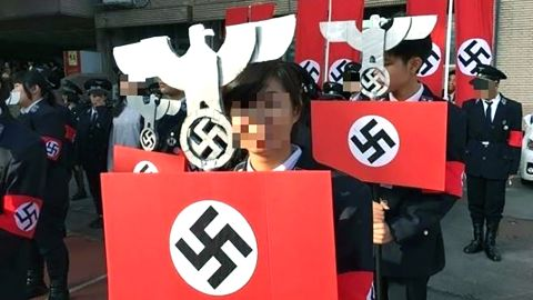 School students whose faces have been digitally obscured, wearing Nazi uniforms at the school in Hsinchu, western Taiwan, on December 23.