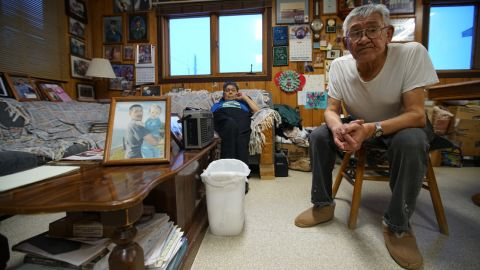 Shelton and Clara Kokeok are among the residents who say they won't leave the town, about 30 miles from the Arctic Circle. Their son, Norman, shown in the photograph, was killed when he fell through sea ice in 2007. They blame climate change for his death.