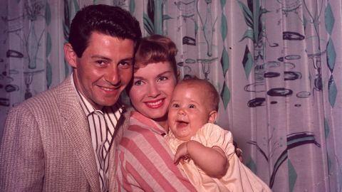 A family portrait of Fisher, Reynolds and daughter Carrie, circa 1957.