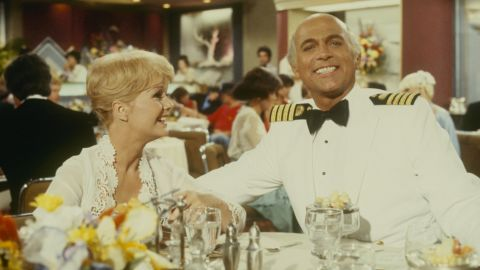 """Reynolds appears in an episode of """"The Love Boat"""" with Gavin MacLeod in 1980."""