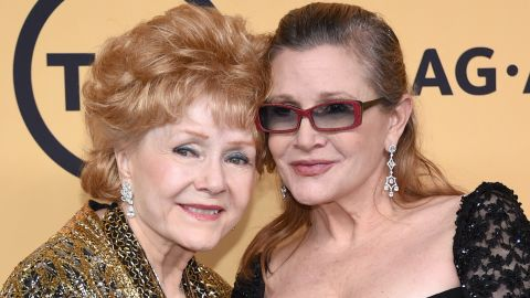 Reynolds poses with daughter Carrie Fisher after receiving the Screen Actors Guild Life Achievement Award on January 25, 2015, in Los Angeles.
