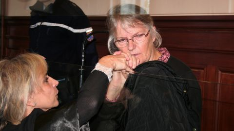 Jacqueline Sauvage is seen with her lawyer during her trial in Blois, France, in December.