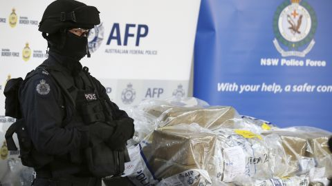 A police officer guards a haul of drugs that are on display at an Australian Federal Police office in Sydney, Australia, Thursday, Dec. 29, 2016. Officials have seized more than a ton of cocaine worth about 360 million Australian dollars ($260 million) in what police have dubbed one of the largest drug busts in the nation's history. (AP Photo/Rick Rycroft)