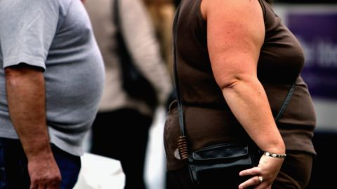 An overweight person walks through Glasgow city center on October 10, 2006 in Glasgow, Scotland. According to government health maps, people in the north of England lead less healthy lifestyles compared to those in the south.