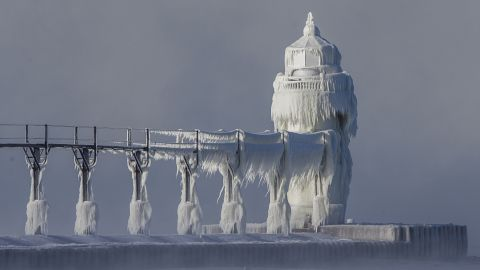 Extreme cold conditions cause ice accretions to cover the St. Joseph lighthouse and pier, on the southeastern shoreline of Lake Michigan in St. Joseph, Mich., on Monday, Dec. 19, 2016. (Robert Franklin/South Bend Tribune via AP)