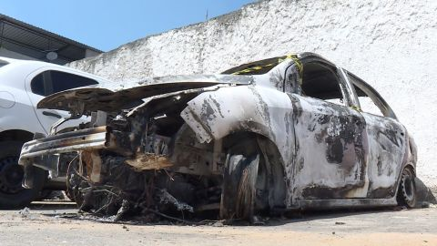 AFP video shows the burned-out rental car of missing Greek ambassador to Brazil Kyriakos Amiridis at a parking lot outside a police station.