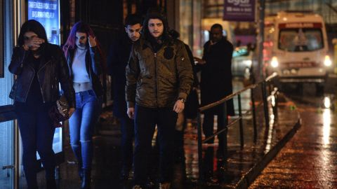 People leave the scene of the attack.
