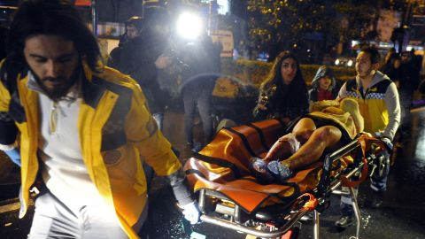 A wounded victim is rushed from the scene.