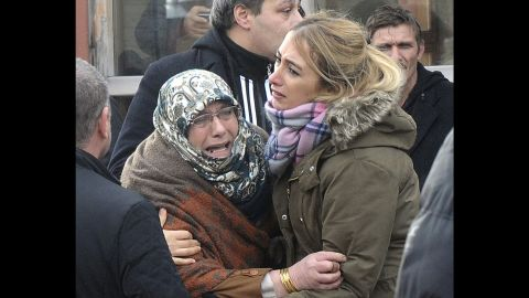 People mourn outside the Forensic Medical Center in Istanbul on January 1.