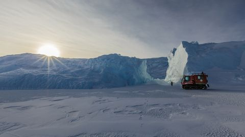 <strong>Logistics:</strong> United States Antarctic Program researchers and support staffers use different types of tracked vehicles to safely travel along the sea ice. A PistenBully is used to assess sea ice routes for safe travel.