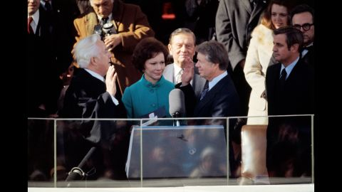 Jimmy Carter is joined by his wife, Rosalynn, as he takes the oath of office in 1977. He was the first president to walk from the Capitol to the White House in the post-inauguration parade.