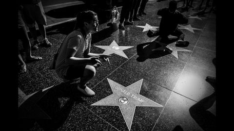 A woman stops at Trump's star on the Hollywood Walk of Fame in June 2016.