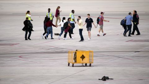 Officials said it's too early in the investigation to know for certain what prompted a man to open fire on people at the baggage claim area in Terminal 2.