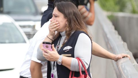 People react after the shooting at the Fort Lauderdale airport. The first call about the incident came in at 12:55 p.m. ET, authorities said.