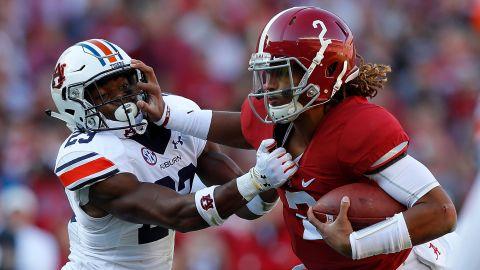 Alabama QB Jalen Hurts, #2, in red.