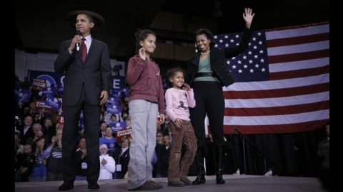 With his wife Michelle and daughters Malia and Sasha by his side Democratic Presidential hopeful Senator Barack Obama speaks to voters during a rally at Roosevelt High School January 1, 2008 in Des Moines, Iowa.
