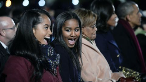 Malia and Sasha Obama, grandmother Marian Robinson, the first lady and President attend the National Christmas Tree lighting ceremony on the Ellipse south of the White House in December 2015.