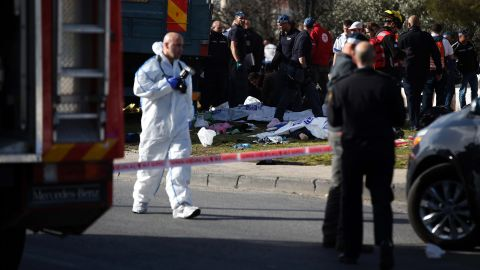 A truck plowed into a group of soldiers in Jerusalem Sunday, killing four and injuring at least 13.