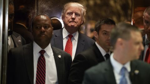Trump gets on an elevator after speaking with reporters at New York's Trump Tower on January 9.