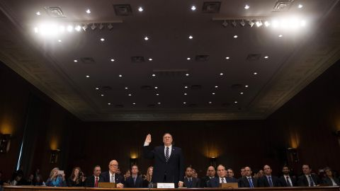 """Pompeo is sworn in at <a href=""""http://www.cnn.com/2017/01/12/politics/mike-pompeo-cia-director-hearing-donald-trump/"""" target=""""_blank"""">his confirmation hearing.</a> Along with Russia, Pompeo said other global threats include Iran's growing influence in the Middle East, ISIS' grip over major urban areas, and the conflict in Syria."""